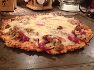 This pizza's toppings were chicken, red onions, minced garlic, red pepper flakes, oregano, basil and cumin.